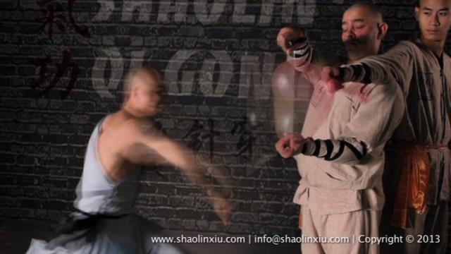 Epic Stunts - Shifu Shi Yan Xiu Throws A Needle Through Glass - Shaolin Qi Gong