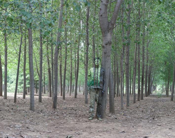 Liu Bolin hitc No-94 in the Woods Photograph 2010 (Credit: Liu Bolin)